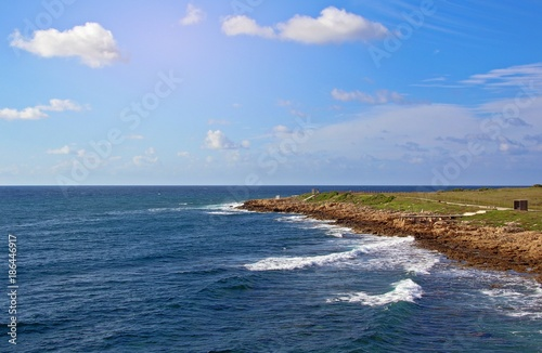 Staande foto Cyprus Coastal broadwalk in a clear blue sky in Paphos. Cyprus coastline of Mediterranean Sea