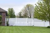Contemporary White vinyl fence enclosing a backyard - 186456913