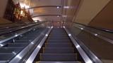 riding the escalator upwards in nice building 4k gimbal smooth pov - 186467576