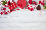Roses and red hearts on a wooden background and gifts in boxes