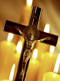Crucifix and church candles poster