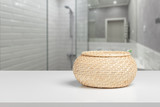 Straw decorative basket on a white desk front view - 186499706
