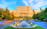 One of the famous and biggest building in the world Palace of Parliament illuminated by sunrise light in the most beautiful place of Bucharest, capital of Romania in Eastern Europe - 186499979