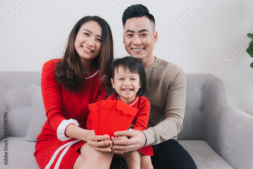 Happy Vietnamese family celebrate Lunar new year at home.