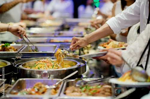 Wall mural scooping the food. Buffet food at restaurant. Catering food
