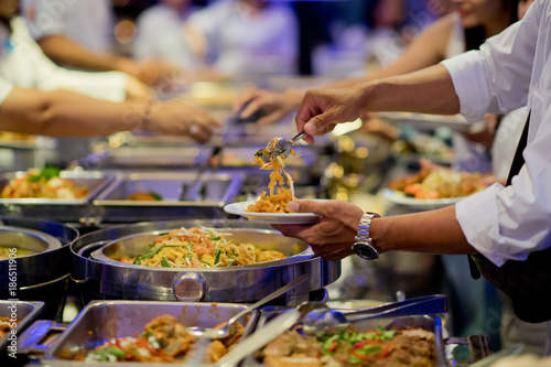 scooping the food. Buffet food at restaurant. Catering food - 186511906