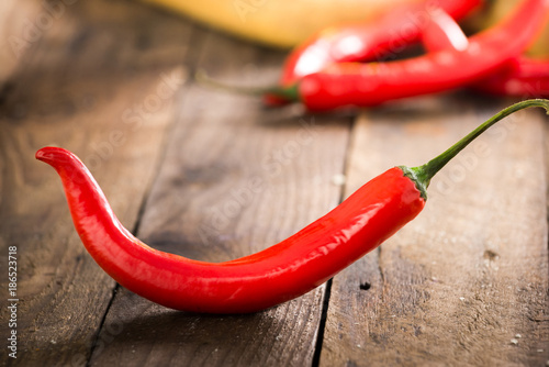 Foto op Canvas Hot chili peppers chili on wood