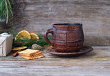 large ceramic coffee mug and crackers on wooden table - 186526758