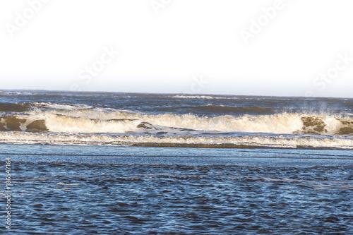 Foto op Canvas Noordzee Wellen im Sturm am Meer in Deutschland