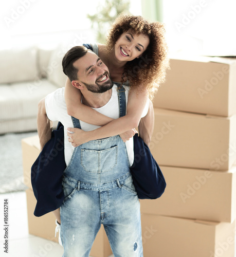 Portrait of a couple in love in a new empty apartment.