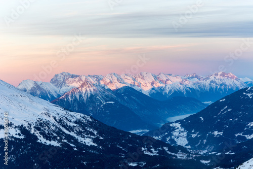 "Snowy mountains with the ""Zugspitze"" the hightest mountain in Germany with pink sky"