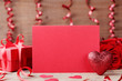 Valentines day mockup. Red heart, paper card and gift on wooden table.