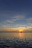 A view of the calm golden sunset on the river with the sun reflected in it, Volga, Russia - 186557145