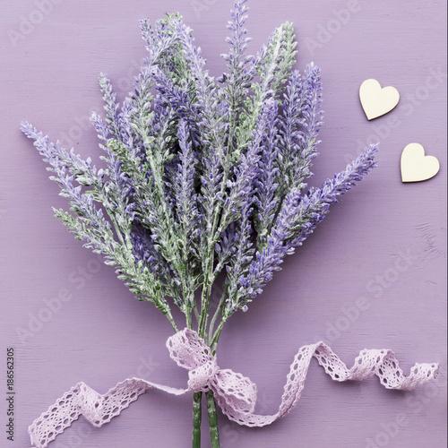 Lavender flower on purple wooden background. - 186562305