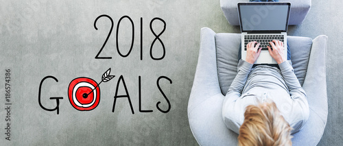 Foto op Canvas Snelle auto s 2018 Goals with man using a laptop in a modern gray chair