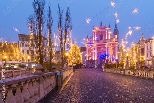 Presern square, Triple bridge and Franciscan Church of the Annunciation decorared by Christmas lights in Ljubljana, Slovenia - 186577741
