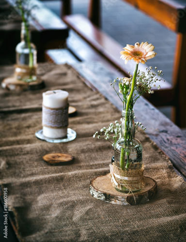 Foto Murales Wedding decoration on the table, tablecloth and other decoration made of burlap