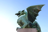 Dragon sculpture on The Dragon Bridge - historical landmark in Ljubljana, Slovenia.