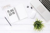 Minimal work space - Creative flat lay photo of workspace desk with Plan 2018 New Year list notebook and laptop on wooden background. Top view flat lay photography. 2018 happy new year concept. - 186629955