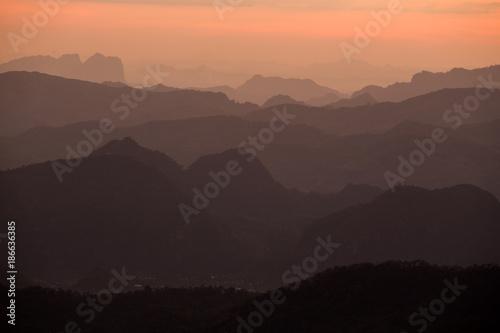Staande foto Diepbruine Misty mountain forest landscape in the evening. Tak , Thailand