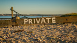 Sign: Private, seen at Shellness Beach on the Isle of Sheppey, Kent, England, UK - 186641999