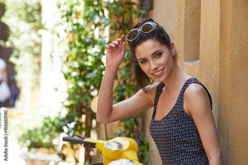Poster Beautiful fashion woman outdoor on the street of the old Italy town