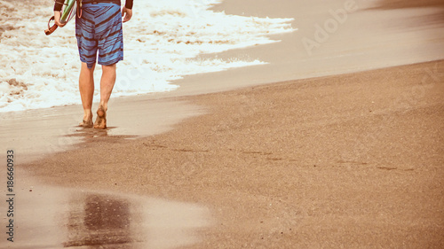 Foto op Canvas Bali Surfer walking along beach