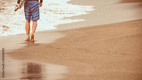 Fotobehang Bali Surfer walking along beach