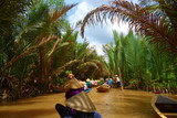 My Tho, Vietnam: Tourist at Mekong River Delta jungle cruise with unidentified craftman and fisherman rowing boats on flooding muddy lotus field in Mekong delta into Ho Chi minh city - 186668174