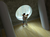 young couple in front of a round window