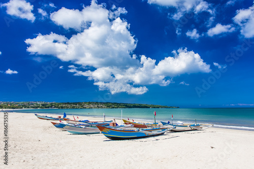 Plexiglas Bali Traditional Bali fishing boats grounded on Jimbaran Beach