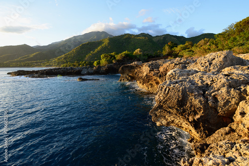 Foto Murales Cuban coast at the foot of mountains Sierra Maestra and above the coast of the Caribbean sea