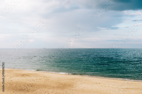 Fotobehang Beige View of the beach and calm sea in summer
