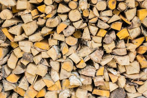 In de dag Brandhout textuur Stack of wood or firewood, hacked trunks
