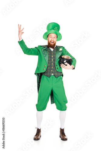 Foto Murales excited leprechaun gesturing and holding pot of gold, isolated on white