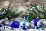 Christmas holiday setting with blue baubles and snowflakes. Christmas background