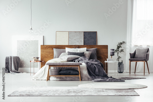 Rugs in monochromatic bedroom interior - 186702502