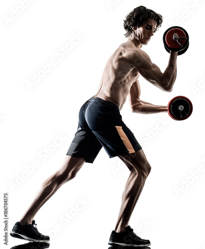one caucasian man fitness weitghs training exercises  studio in silhouette isolated on white background - 186704575