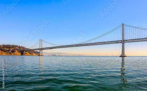 Foto Murales Oakland Bay Bridge in the evening, San Francisco