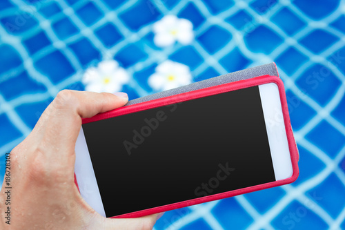 Smartphone with black screen near pool. Vacation concept - 186728303