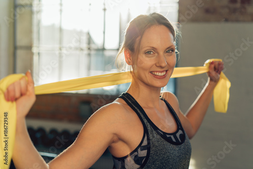 Smiling healthy relaxed athletic young woman - 186729348