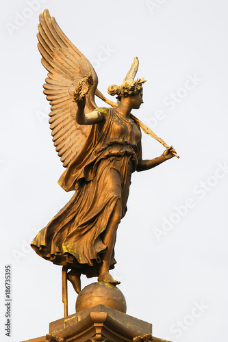 Statue of an angel at the Rudolfinum in Prague - 186735395