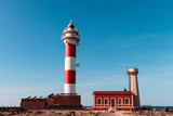 Lighthouse in the North of Fuerteventura on blue sky - 186737530
