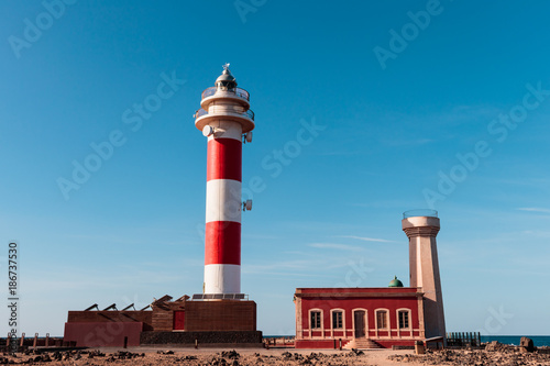 Lighthouse in the North of Fuerteventura on blue sky Poster