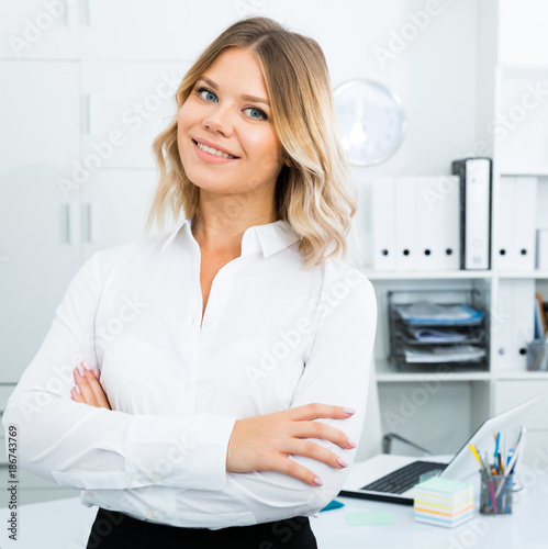 Kindness girl in white shirt in modern office close-up