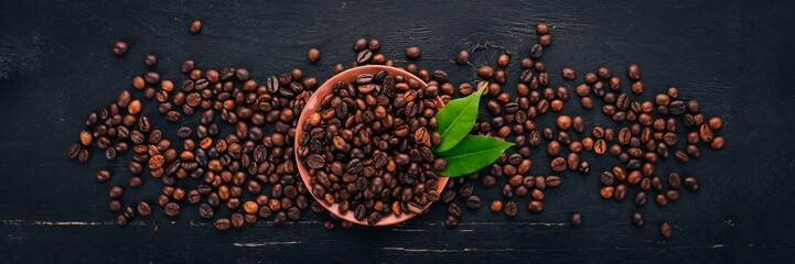Coffee beans. On a wooden background. Top view. Copy space. © Yaruniv-Studio