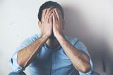 Depressed man hand face - 186754392