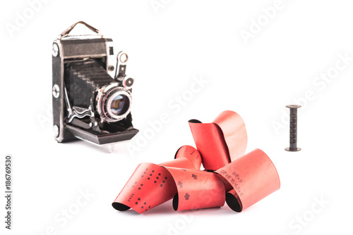Poster Retro 120 film for medium format retro cameras on white background with shadows,