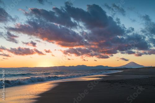 Fotobehang Blauwe jeans Mountain Fuji and sea wave in sunset at Shonan Coast,Kanagawa prefecture,Japan