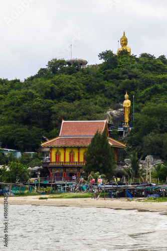 Fotobehang Boeddha A view from the beach and Monkey Mountain with golden Buddha statues in Hua Hin, Thailand